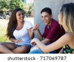 latin woman talking with... | Shutterstock . vector #717069787