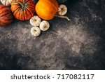 orange and white pumpkins on a...   Shutterstock . vector #717082117