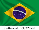 brazil flag background with... | Shutterstock .eps vector #717123583