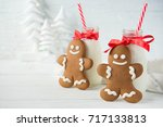 gingerbread men and bottles of... | Shutterstock . vector #717133813
