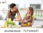 father and daughter making meal ... | Shutterstock . vector #717144247