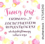 fancy calligraphy font with... | Shutterstock .eps vector #717145243