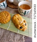 """Small photo of Mooncake comes in big,medium and small sizes and they are also made into the shape of animals / Traditional and Animated Mooncake / The Chinese character represent """"lotus paste"""""""