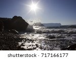 nature ocean mountains in the... | Shutterstock . vector #717166177