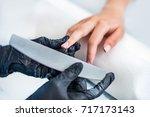filing fingernails at nail salon   Shutterstock . vector #717173143
