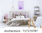 gray fur duvet covering a king...   Shutterstock . vector #717174787