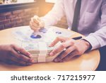 businessman's hand is giving... | Shutterstock . vector #717215977