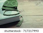 greens holy quran book with... | Shutterstock . vector #717217993