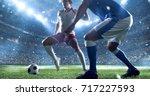 soccer player kicks the ball on ...   Shutterstock . vector #717227593