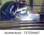 male welding steel beam... | Shutterstock . vector #717234667