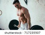 attractive tall muscular... | Shutterstock . vector #717235507