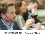man tasting wine   Shutterstock . vector #717237877
