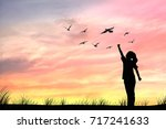 silhouette women and dove birds ... | Shutterstock . vector #717241633