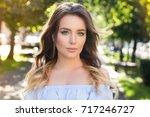 outdoors portrait of beautiful... | Shutterstock . vector #717246727