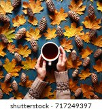 floral autumn background. a mug ... | Shutterstock . vector #717249397