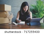 asian business woman selling... | Shutterstock . vector #717255433