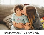 beautiful young mother with... | Shutterstock . vector #717259207
