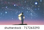 the boy holding glowing moon... | Shutterstock . vector #717263293