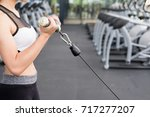 young woman execute exercise... | Shutterstock . vector #717277207