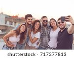 group of young people having... | Shutterstock . vector #717277813