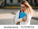 image of pretty brunette woman... | Shutterstock . vector #717278713
