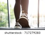 young woman execute exercise in ... | Shutterstock . vector #717279283