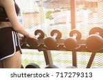 young woman execute exercise in ... | Shutterstock . vector #717279313