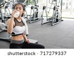 young woman drinking water in... | Shutterstock . vector #717279337