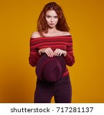 young redhead woman in autumn... | Shutterstock . vector #717281137