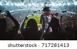 group of fans are cheering for... | Shutterstock . vector #717281413