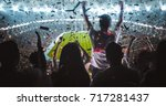 group of fans are cheering for... | Shutterstock . vector #717281437