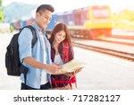 happy asian couple traveler...   Shutterstock . vector #717282127