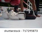 white boxing gloves on the ring ... | Shutterstock . vector #717295873