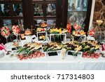 dinner table with sliced fruits ... | Shutterstock . vector #717314803