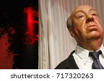 Small photo of Los Angeles CA USA - 28 OCT 2013: Sir Alfred Joseph Hitchcock waxwork figure - Madame Tussauds Hollywood.