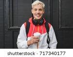 happy handsome caucasian man... | Shutterstock . vector #717340177