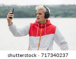 fashionable young hipster man... | Shutterstock . vector #717340237