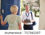 senior woman opens door to male ...   Shutterstock . vector #717362107