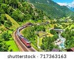 freight train climbs up the... | Shutterstock . vector #717363163