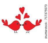 two kissing bird family couple. ...
