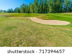 sand bunkers at the golf course. | Shutterstock . vector #717394657