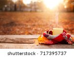 tea mug covered with warm scarf ... | Shutterstock . vector #717395737