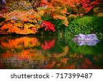 Small photo of Eikando Temple is famous for its great amount of maple in the zen garden.The stone and maple reflected in the lake, November, Kyoto, Japan.