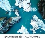 aerial view of amazing glacier... | Shutterstock . vector #717409957