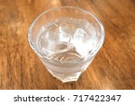 glass of drink water on wooden... | Shutterstock . vector #717422347