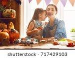 mother and her daughter having... | Shutterstock . vector #717429103