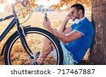 resting after a bike ride.... | Shutterstock . vector #717467887