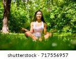 a beautiful young sporty girl... | Shutterstock . vector #717556957