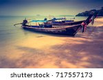 longtail boats at the tropical... | Shutterstock . vector #717557173