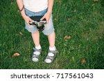hands and legs of little boy... | Shutterstock . vector #717561043